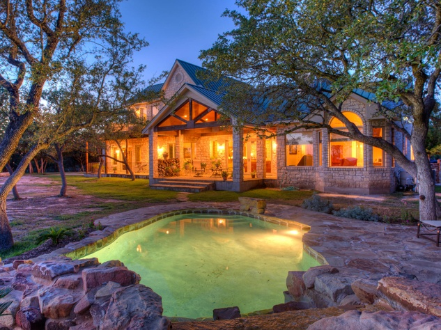 Red Adair ranch home exterior with pool