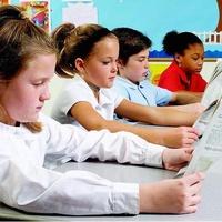 Houston, kids reading paper, August 2017