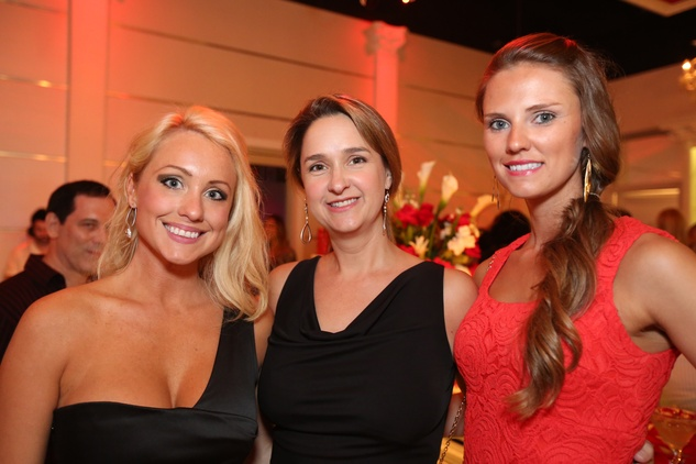 2811 Meghann Smith, from left, J.L. Carpenter and Brandee Karr at the Crimson grand opening party July 2014