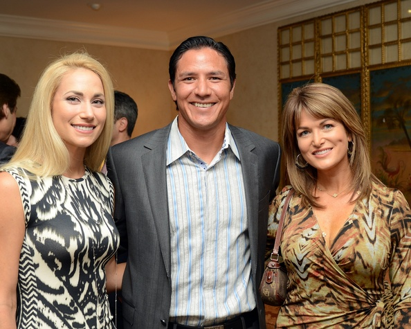 7 Liz and Brian Ching, from left, with Melissa Wilson at the Celebration of Champions kick-off September 2014