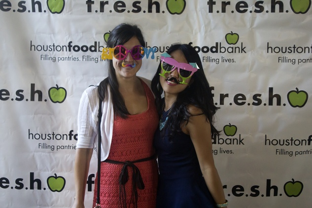 Laura Novia, left, and Chloe Kwon at the f.r.e.s.h. new young professionals group party june 2014