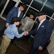 Alden Davenport shakes hands with Butch Layne at M Penner Magritte party