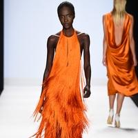 Fashion Week spring 2015 Project Runway model in orange fringe dress