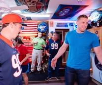 J.J. Watt delivers pizza checks out man cave of Wayne Lominac