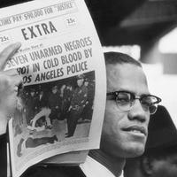 Gordon Parks Malcolm X Holding up Black Muslim Newspaper