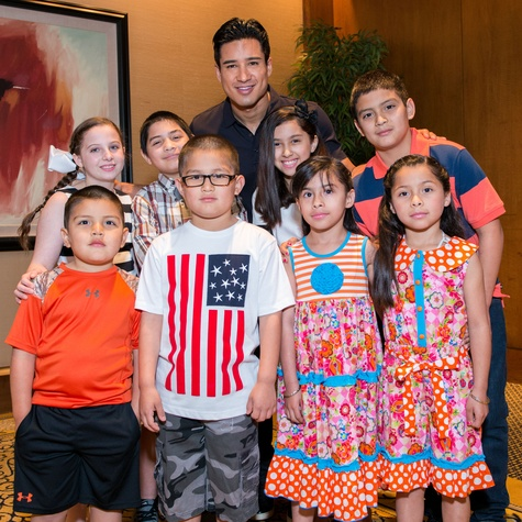303 Mario Lopez and Harbor children at the Boys & Girls Harbor Fashion Show April 2015