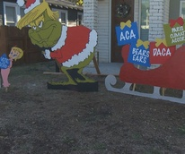 Donald Trump Grinch holiday display Austin