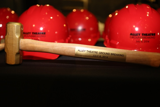 9 Construction hats and sledge hammer at the Alley Theatre groundbreaking luncheon July 2014