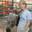 Child volunteering at equine therapy center in Houston