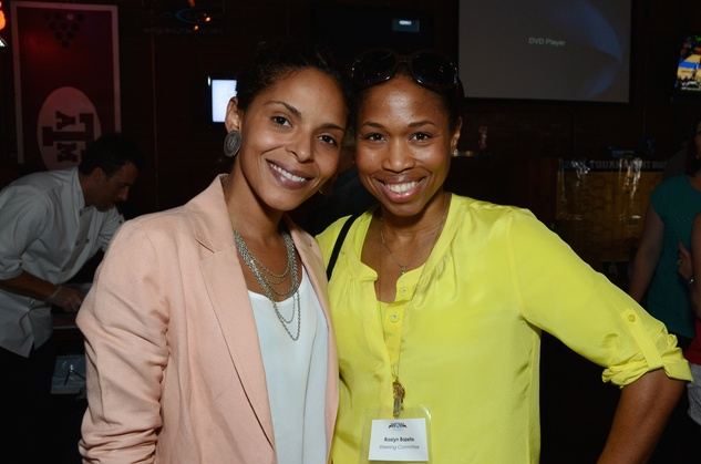 Zsavon Butler, left, and Roslyn Bazelle at the Women of Wardrobe Spring Fling March 2014