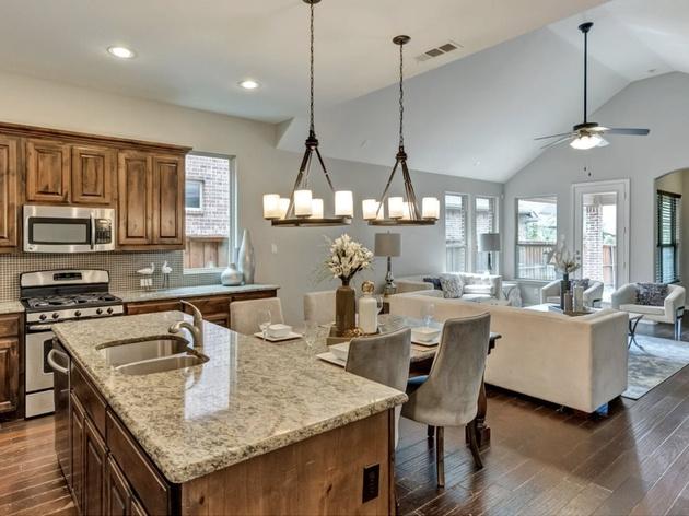 open concept kitchen with granite countertops & home interior