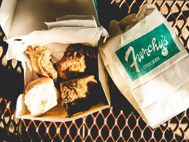 Frenchy's Fried Chicken fried chicken in a box on patio table December 2013 from IAm.Beyonce.com