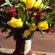 Flower arrangement in cowboy boot at Casey Curry baby shower January 2014