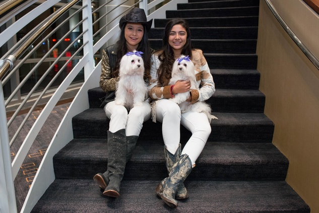 Regina Valdes with Luna, from left, and Alexa Biendis with Fendi at the Citizens for Animal Protection Gala November 2014