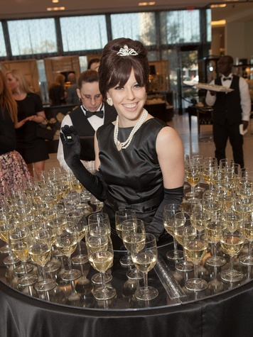 2. Model serving wine at the Little Black Dress designer kick-off party and fashion show March 2014