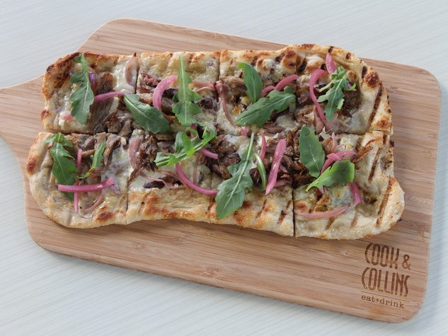 Cook & Collins Houston January 2014 party fowl flatbread with duck leg, candied bacon, pickled shitake, bleu cheese and arugula