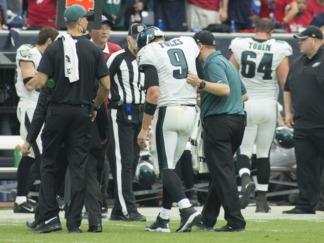 Texans vs. Eagles Eagles quarterback injury with replacement November 2014 Nick Foles escorted off field