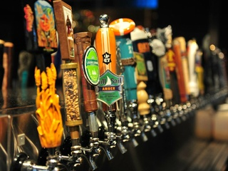 Beer taps at Henry's Tavern in Plano