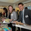 United Way promoted article November 2014 Pictured sorting books for United Way Tiny Libraries are Michelle Lynch and Chris Frey.