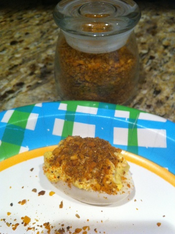 deviled egg with spices on top
