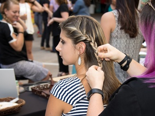 Guest having her hair braided at Hello Summer Social