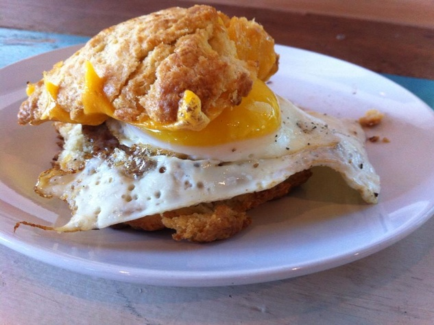 Blacksmith Houston scratch-made biscuits, freshly made sausage, ole dad farm's eggs and sharp cheddar