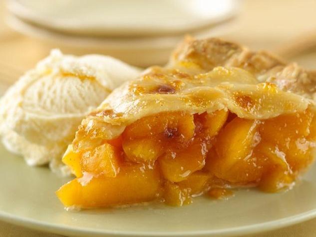 peach pie slice with ice cream