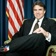 Rick Perry wearing cowboy boots and a suit