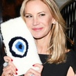 Dee Ocleppo with mink evil eye clutch at Plaza apartment