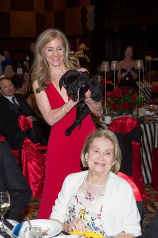 7 Michele Hobbs with Susie Q, left, and Camille Tichenor at the Covenant House Gala March 2015