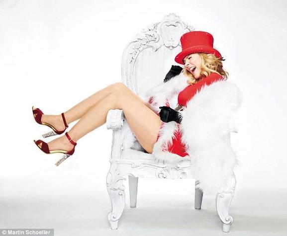 Kim Cattrall as sexy Santa in chair