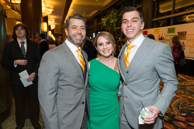 0167 Trey Martinez, left, with Jan and Oneil Mendenhall at the Cristo Rey Jesuit Gala January 2015