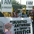 Black Heritage Society of Houston Original MLK Parade members of crowd holding signs January 2014