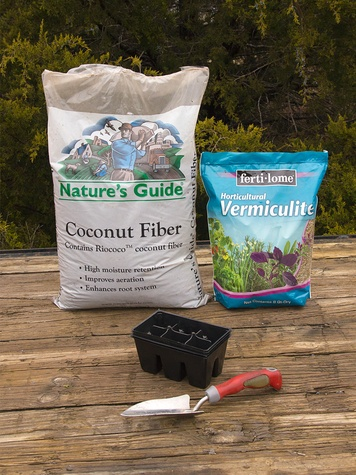 bags of vermiculite and coconut coir with seed starting tools