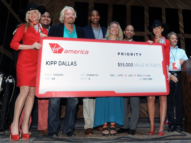 Richard Branson presents a check to KIPP DFW