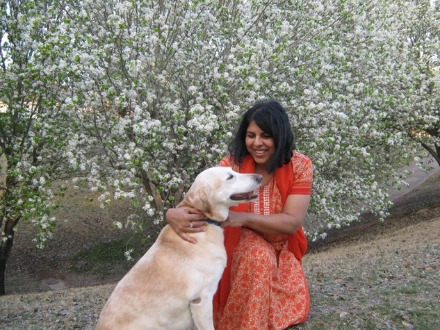 Chitra Divakaruni with dog and flowers
