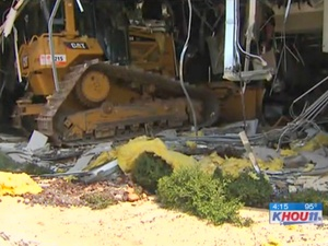 bulldozer, building, disgruntled employee, Ritchie Bros auction house