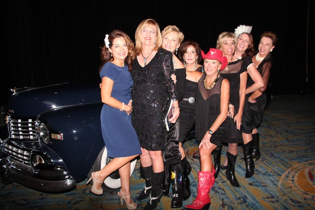 20 Members of the 2014 Jeans & Jewels committee and friends at the Northwest Ministries Jeans & Jewels Gala October 2014