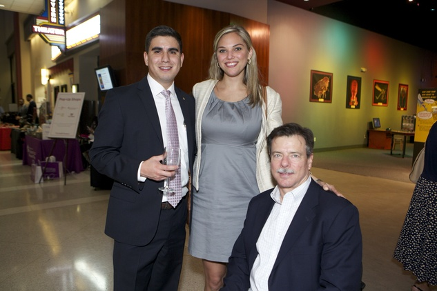 1319 Josh Campos, from left, Kristen Zinser and Michael Leiser at the Passport to the World wine and food event at The Health Museum October 2014