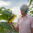 Photo of Marshall Hinsley with sunflower