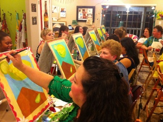group of student artists painting in class at GeeBerry Art Studio