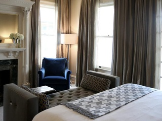 interior of room at Hotel Ella with bed and chair