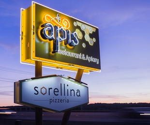 Apis Restaurant and Apiary Pizzeria Sorellina sign