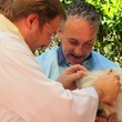 """11 Katie Oxford Blessing of the Animals at Bellaire United Methodist March 2015 Pastor Jim Flagg, """"Covert Commander Chaos"""" a westie, and owner, Eric"""