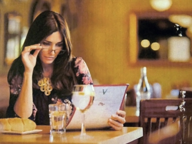 women using glasses to read a menu