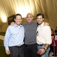 Jamey Rootes, from left, Rick Perez and Ernie Cockrell at The Society for Leading Medicine Houston Texans Family Field Day May 2014