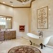 Bathtub in middle of bathroom