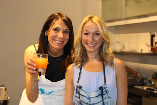 Debbie Rosengart, left, and Erin O' Leary Stewart at the Define Body & Mind cocktail party July 2014