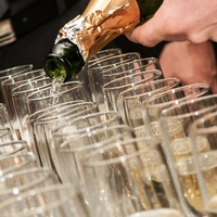 pouring champagne wine into glasses