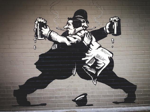 drinking mural outside of The Ginger Man Austin